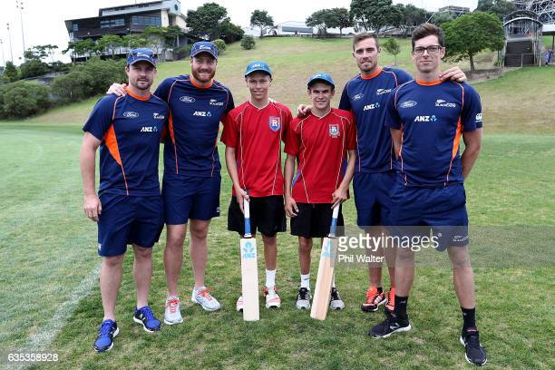 Kyle Kieser and Dylan Taylor of Rangitoto College pose with Martin Guptill Tim Southee Colin Munro and Mitch Santner of the BLACKCAPS as they make a...
