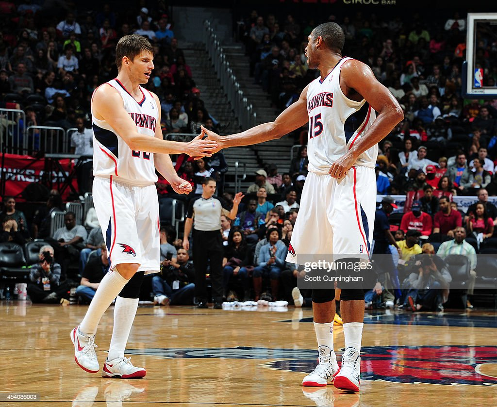 <a gi-track='captionPersonalityLinkClicked' href=/galleries/search?phrase=Kyle+Korver&family=editorial&specificpeople=202504 ng-click='$event.stopPropagation()'>Kyle Korver</a> #26 and <a gi-track='captionPersonalityLinkClicked' href=/galleries/search?phrase=Al+Horford&family=editorial&specificpeople=699030 ng-click='$event.stopPropagation()'>Al Horford</a> #15 of the Atlanta Hawks shake hands against the Cleveland Cavaliers on December 6, 2013 at Philips Arena in Atlanta, Georgia.