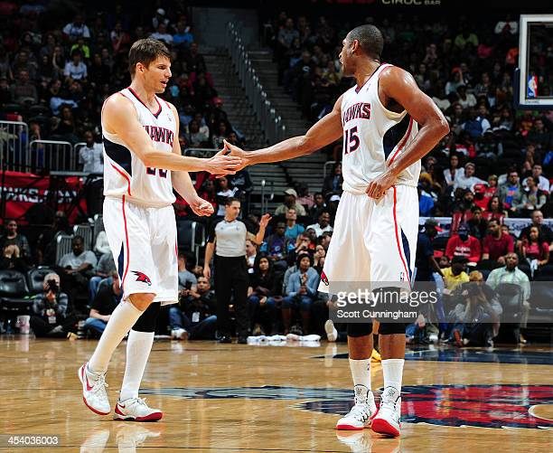 Kyle Korver and Al Horford of the Atlanta Hawks shake hands against the Cleveland Cavaliers on December 6 2013 at Philips Arena in Atlanta Georgia...