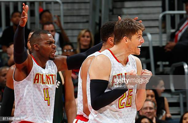 Kyle Korver and Paul Millsap of the Atlanta Hawks reacts to a call against the Hawks during the first overtime against the Milwaukee Bucks at Philips...