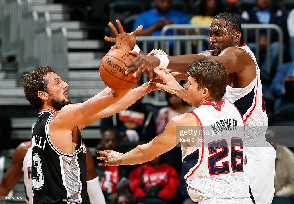 <a gi-track='captionPersonalityLinkClicked' href=/galleries/search?phrase=Kyle+Korver&family=editorial&specificpeople=202504 ng-click='$event.stopPropagation()'>Kyle Korver</a> #26 defends as <a gi-track='captionPersonalityLinkClicked' href=/galleries/search?phrase=Elton+Brand&family=editorial&specificpeople=201501 ng-click='$event.stopPropagation()'>Elton Brand</a> #42 of the Atlanta Hawks blocks a pass by <a gi-track='captionPersonalityLinkClicked' href=/galleries/search?phrase=Marco+Belinelli&family=editorial&specificpeople=847592 ng-click='$event.stopPropagation()'>Marco Belinelli</a> #3 of the San Antonio Spurs at Philips Arena on October 17, 2013 in Atlanta, Georgia.