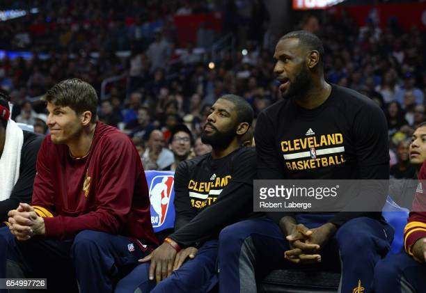 Kyle Korver Kyrie Irving and Lebron James of the Cleveland Cavaliers sitting out the game against the Los Angeles Clippers on March 18 2017 at...