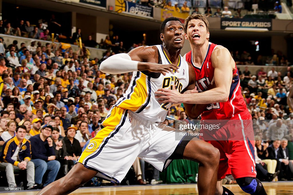 Kyle Korver #26 of the Atlanta Hawks battles for rebound position against Ian Mahinmi #28 of the Indiana Pacers in Game Five of the Eastern Conference Quarterfinals during the 2013 NBA Playoffs on May 1, 2013 at Bankers Life Fieldhouse in Indianapolis, Indiana.