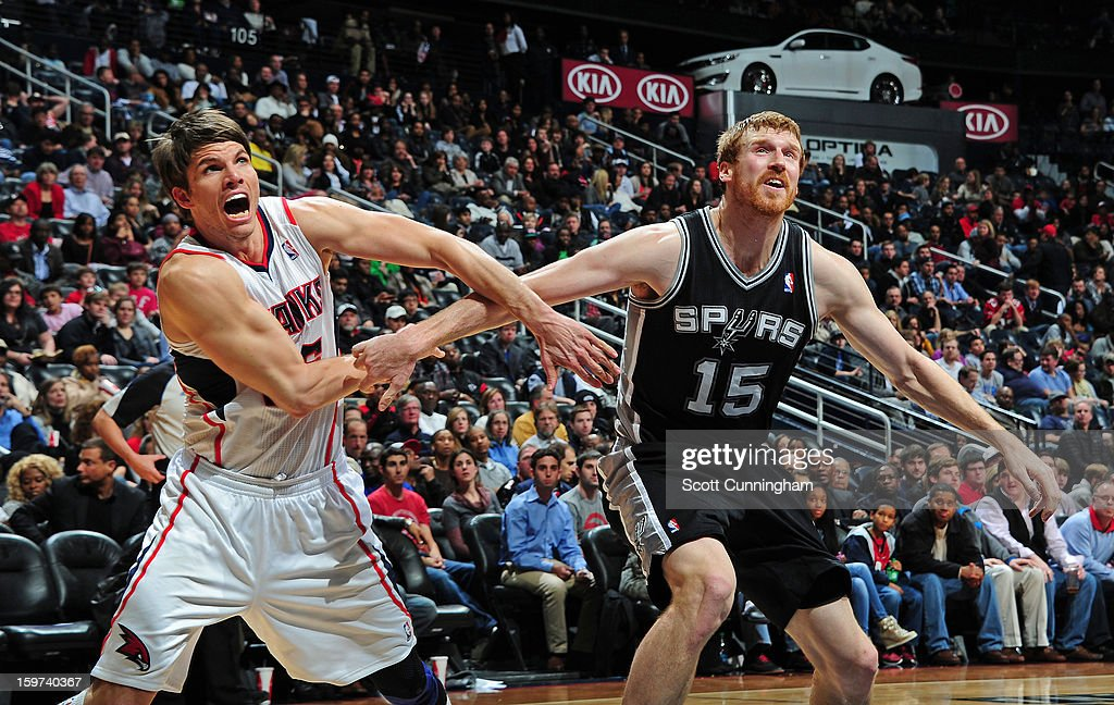 <a gi-track='captionPersonalityLinkClicked' href=/galleries/search?phrase=Kyle+Korver&family=editorial&specificpeople=202504 ng-click='$event.stopPropagation()'>Kyle Korver</a> #26 of the Atlanta Hawks boxes out <a gi-track='captionPersonalityLinkClicked' href=/galleries/search?phrase=Matt+Bonner&family=editorial&specificpeople=203054 ng-click='$event.stopPropagation()'>Matt Bonner</a> #15 of the San Antonio Spurs on January 19, 2013 at Philips Arena in Atlanta, Georgia.