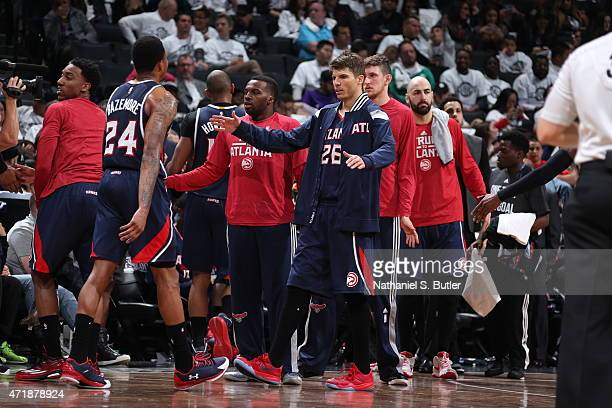 Kyle Korver of the Atlanta Hawks celebrates with his teammates in Game Six of the Eastern Conference Quarterfinals against the Brooklyn Nets during...
