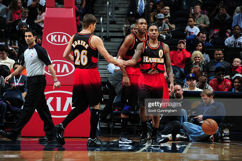 <a gi-track='captionPersonalityLinkClicked' href=/galleries/search?phrase=Kyle+Korver&family=editorial&specificpeople=202504 ng-click='$event.stopPropagation()'>Kyle Korver</a> #26 of the Atlanta Hawks congratulates teammate <a gi-track='captionPersonalityLinkClicked' href=/galleries/search?phrase=Jeff+Teague&family=editorial&specificpeople=4680498 ng-click='$event.stopPropagation()'>Jeff Teague</a> #0 during the game against the Sacramento Kings on February 22, 2013 at Philips Arena in Atlanta, Georgia.