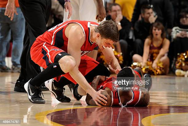 Kyle Korver of the Atlanta Hawks congratulates teammate Jeff Teague after he hit the game winner in double overtime against the Cleveland Cavaliers...