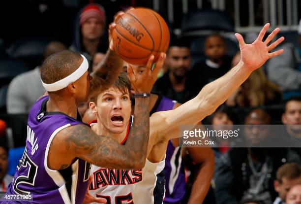Kyle Korver of the Atlanta Hawks defends against Isaiah Thomas of the Sacramento Kings at Philips Arena on December 18 2013 in Atlanta Georgia NOTE...