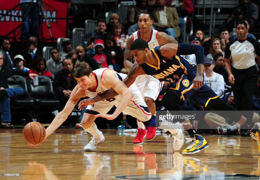 <a gi-track='captionPersonalityLinkClicked' href=/galleries/search?phrase=Kyle+Korver&family=editorial&specificpeople=202504 ng-click='$event.stopPropagation()'>Kyle Korver</a> #26 of the Atlanta Hawks dives for a loose ball against Paul George #24 of the Indiana Pacers on December 29, 2012 at Philips Arena in Atlanta, Georgia.
