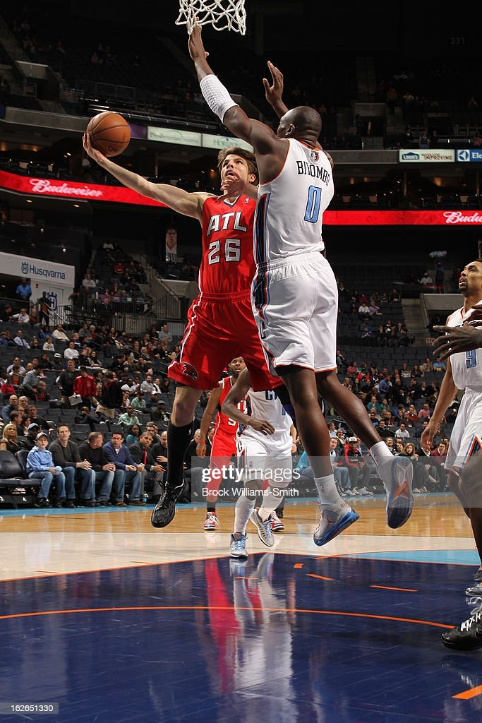 Kyle Korver #26 of the Atlanta Hawks drives to the basket against the Charlotte Bobcats at the Time Warner Cable Arena on January 23, 2013 in Charlotte, North Carolina.
