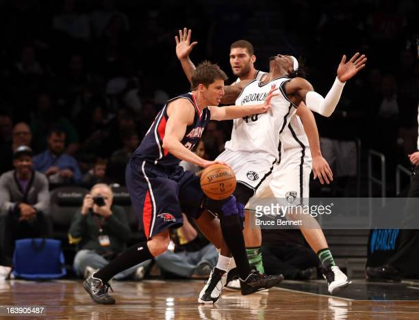 Kyle Korver of the Atlanta Hawks fouls Gerald Wallace of the Brooklyn Nets at the Barclays Center on March 17 2013 in New York City The Hawks...