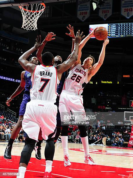 Kyle Korver of the Atlanta Hawks grabs a rebound against the Charlotte Hornets on October 20 2014 at Philips Arena in Atlanta Georgia NOTE TO USER...