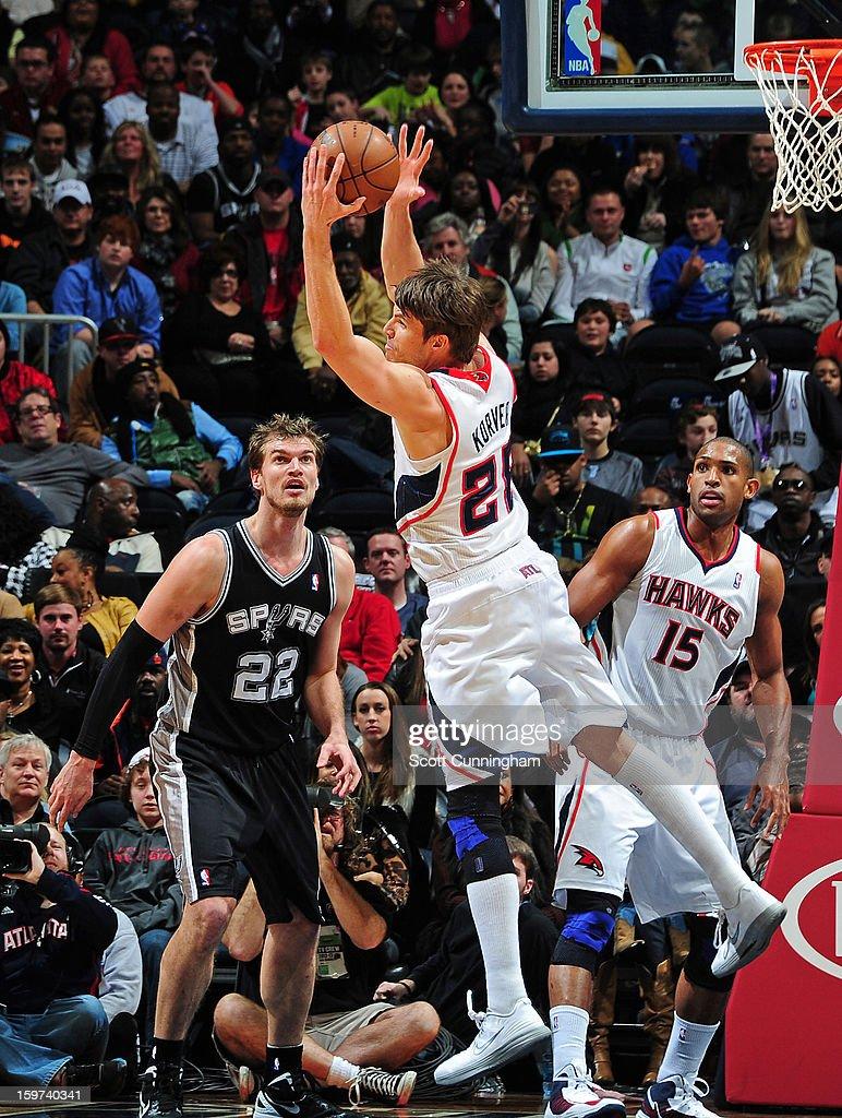 Kyle Korver #26 of the Atlanta Hawks grabs a rebound against the San Antonio Spurs on January 19, 2013 at Philips Arena in Atlanta, Georgia.