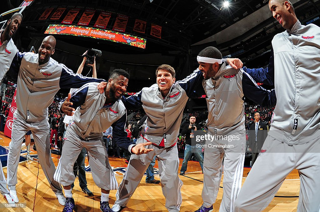 <a gi-track='captionPersonalityLinkClicked' href=/galleries/search?phrase=Kyle+Korver&family=editorial&specificpeople=202504 ng-click='$event.stopPropagation()'>Kyle Korver</a> #26 of the Atlanta Hawks huddles up with teammates before a game against the Chicago Bulls on December 22, 2012 at Philips Arena in Atlanta, Georgia.