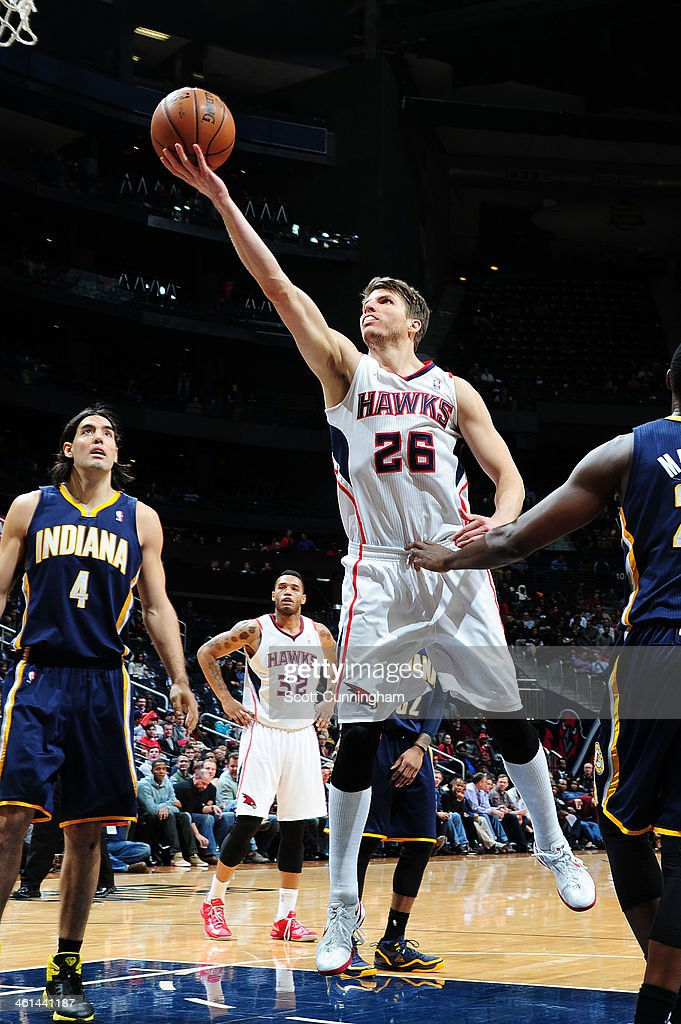 <a gi-track='captionPersonalityLinkClicked' href=/galleries/search?phrase=Kyle+Korver&family=editorial&specificpeople=202504 ng-click='$event.stopPropagation()'>Kyle Korver</a> #26 of the Atlanta Hawks laying a shot up against the Indiana Pacers of the Atlanta Hawks against of the Indiana Pacers on January 8, 2014 at Philips Arena in Atlanta, Georgia.