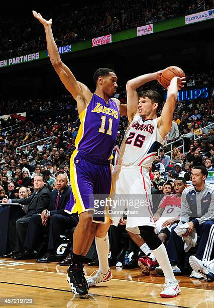 Kyle Korver of the Atlanta Hawks looks to pass the ball against the Los Angeles Lakers on December 16 2013 at Philips Arena in Atlanta Georgia NOTE...