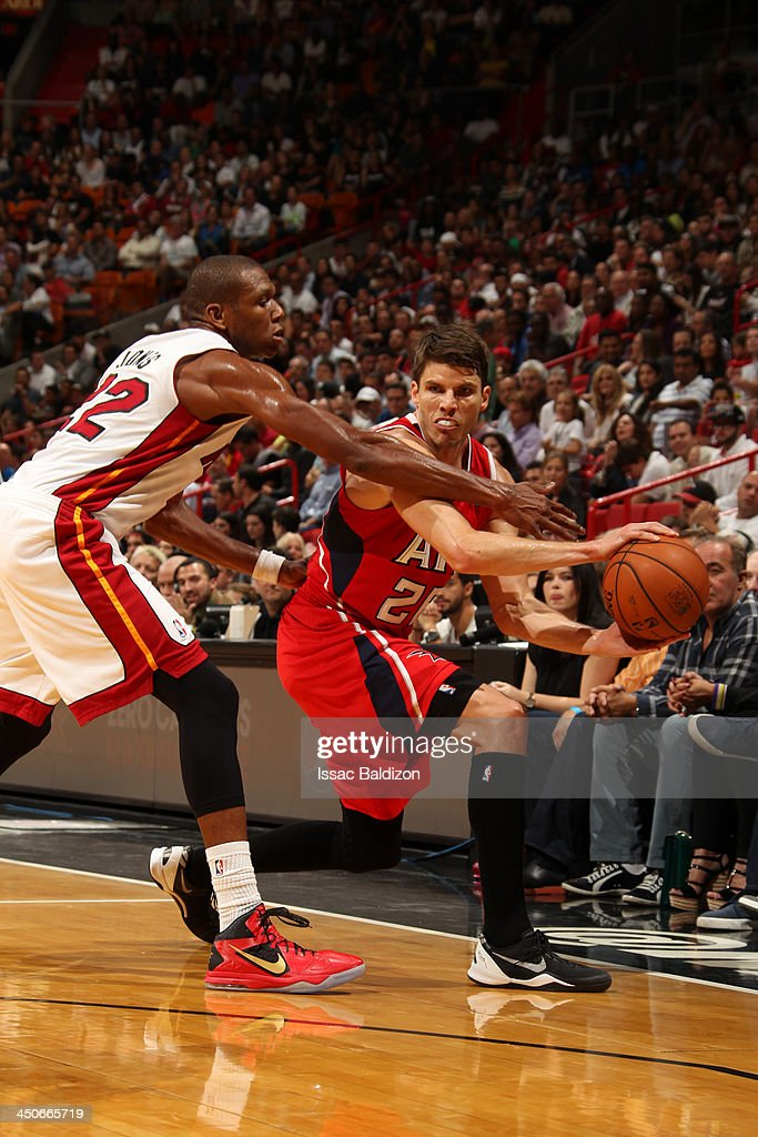 <a gi-track='captionPersonalityLinkClicked' href=/galleries/search?phrase=Kyle+Korver&family=editorial&specificpeople=202504 ng-click='$event.stopPropagation()'>Kyle Korver</a> #26 of the Atlanta Hawks passes the ball against James Jones #22 of the Miami Heat on November 19, 2013 at American Airlines Arena in Miami, Florida.
