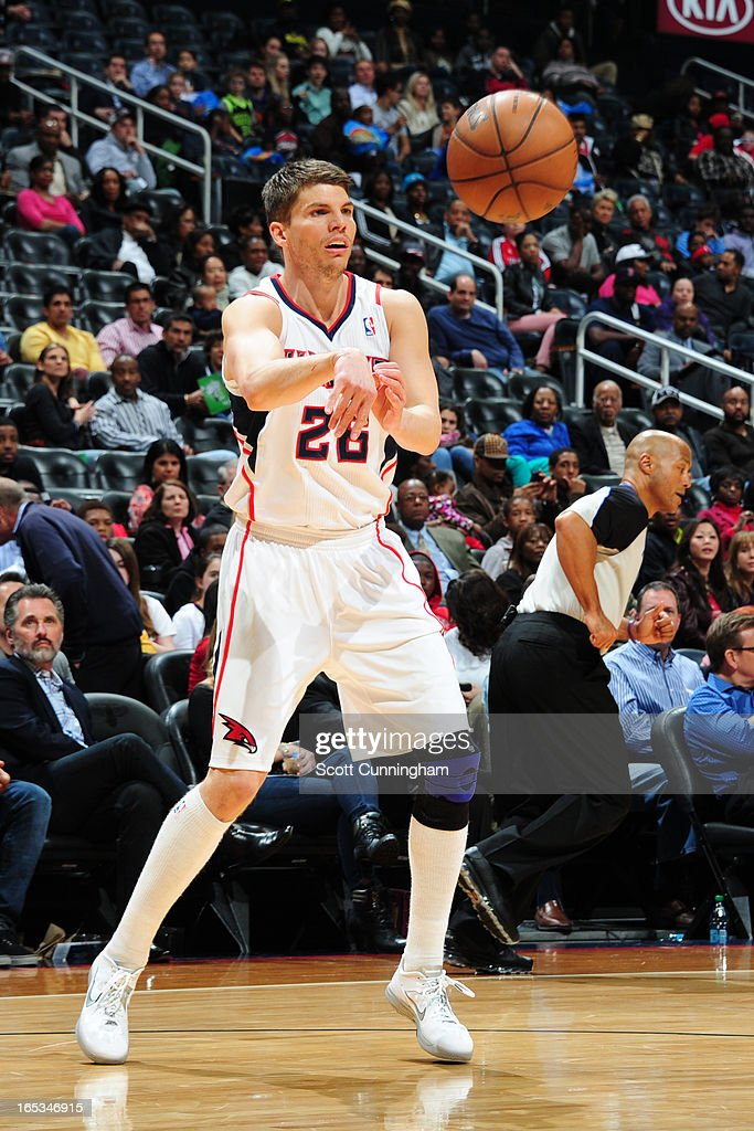 <a gi-track='captionPersonalityLinkClicked' href=/galleries/search?phrase=Kyle+Korver&family=editorial&specificpeople=202504 ng-click='$event.stopPropagation()'>Kyle Korver</a> #26 of the Atlanta Hawks passes the ball against the Portland Trail Blazers on March 22, 2013 at Philips Arena in Atlanta, Georgia.