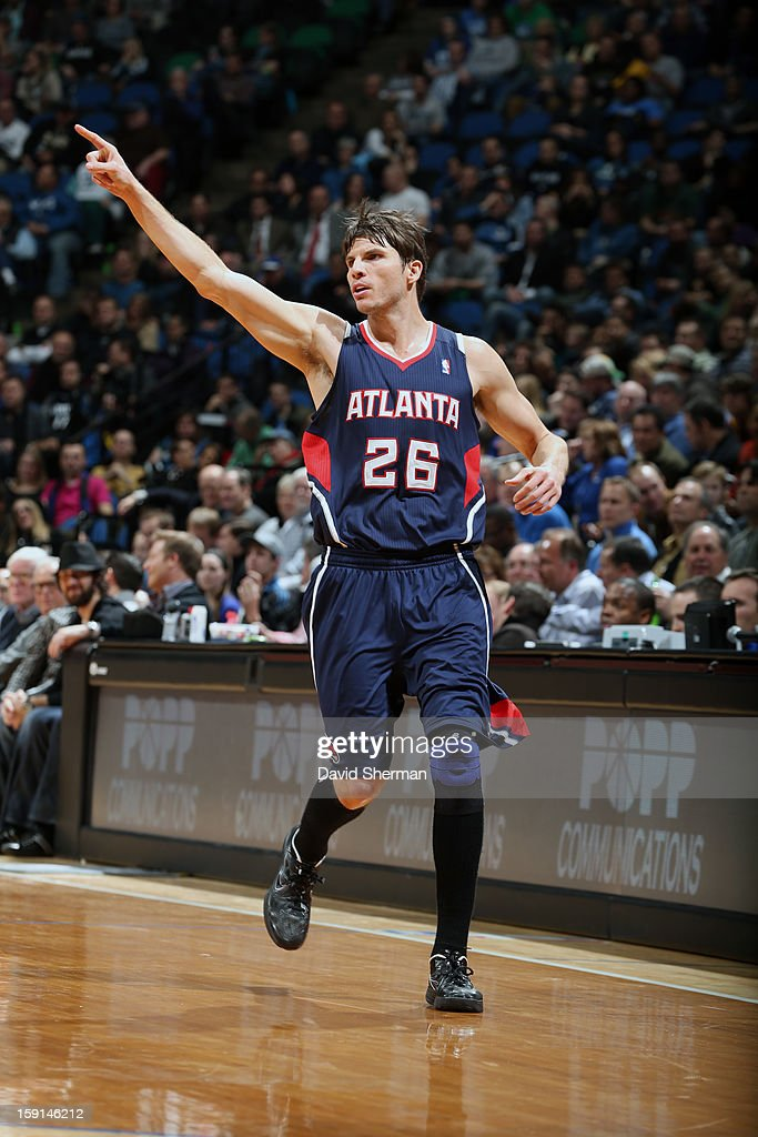 Kyle Korver #26 of the Atlanta Hawks points down court against the Minnesota Timberwolves during the game on January 8, 2013 at Target Center in Minneapolis, Minnesota.