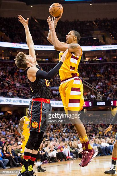 Kyle Korver of the Atlanta Hawks puts pressure on Channing Frye of the Cleveland Cavaliers during the first half at Quicken Loans Arena on April 11...