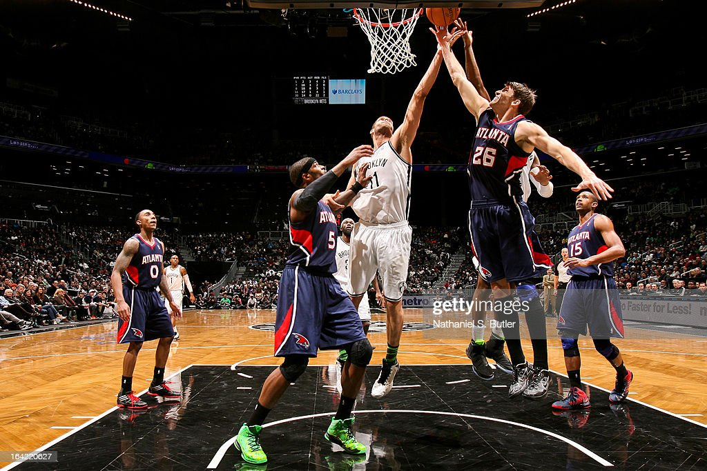 <a gi-track='captionPersonalityLinkClicked' href=/galleries/search?phrase=Kyle+Korver&family=editorial&specificpeople=202504 ng-click='$event.stopPropagation()'>Kyle Korver</a> #26 of the Atlanta Hawks reaches for a rebound against Brook Lopez #11 of the Brooklyn Nets on March 17, 2013 at the Barclays Center in the Brooklyn borough of New York City.