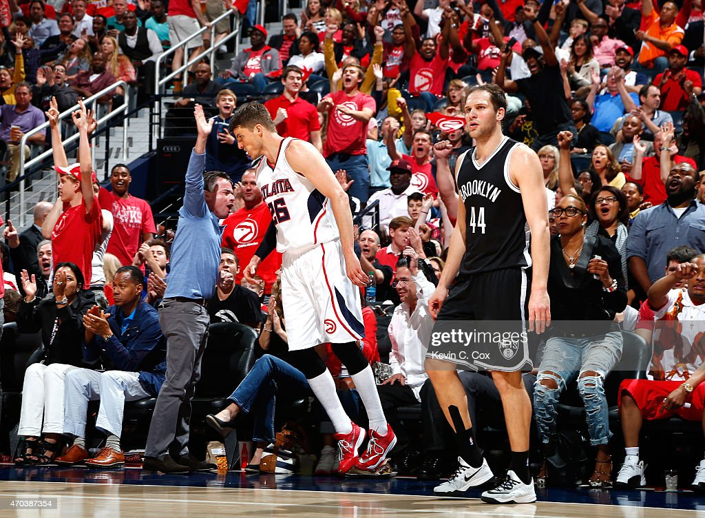 Kyle Korver #26 of the Atlanta Hawks reacts after hitting a three-point basket against Bojan Bogdanovic #44 of the Brooklyn Nets during Game One of the Eastern Conference Quarterfinals of the NBA Playoffs at Philips Arena on April 19, 2015 in Atlanta, Georgia.