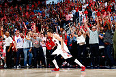 Kyle Korver of the Atlanta Hawks reacts after hitting a threepoint basket over Bradley Beal of the Washington Wizards during Game Two of the Eastern...