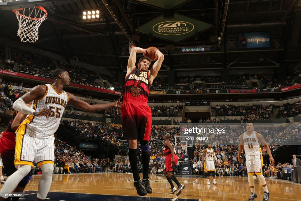 Kyle Korver #26 of the Atlanta Hawks rebounds against the Indiana Pacers on March 25, 2013 at Bankers Life Fieldhouse in Indianapolis, Indiana.