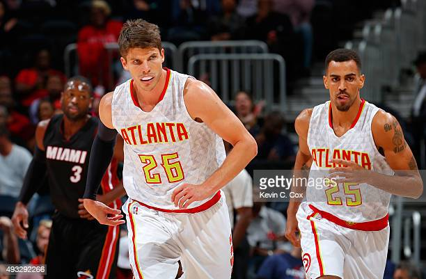 Kyle Korver of the Atlanta Hawks runs down the court after hitting a threepoint basket against the Miami Heat at Philips Arena on October 18 2015 in...
