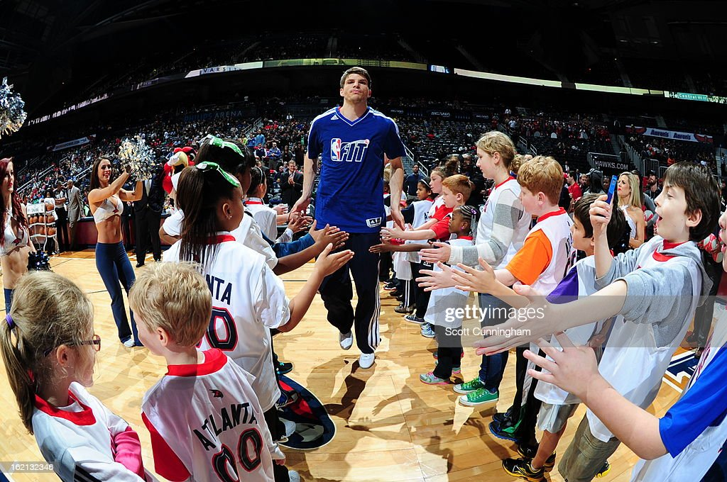 <a gi-track='captionPersonalityLinkClicked' href=/galleries/search?phrase=Kyle+Korver&family=editorial&specificpeople=202504 ng-click='$event.stopPropagation()'>Kyle Korver</a> #26 of the Atlanta Hawks runs out before the game against the Toronto Raptors on January 30, 2013 at Philips Arena in Atlanta, Georgia.