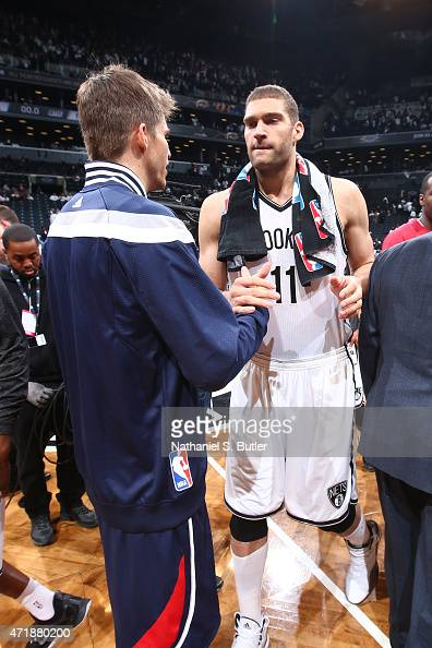 Kyle Korver of the Atlanta Hawks shakes hands with Brook Lopez of the Brooklyn Nets after Game Six of the Eastern Conference Quarterfinals during the...