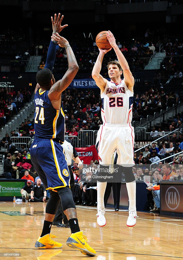 <a gi-track='captionPersonalityLinkClicked' href=/galleries/search?phrase=Kyle+Korver&family=editorial&specificpeople=202504 ng-click='$event.stopPropagation()'>Kyle Korver</a> #26 of the Atlanta Hawks shooting a three pointer during a game against the Indiana Pacers of the Atlanta Hawks against of the Indiana Pacers on January 8, 2014 at Philips Arena in Atlanta, Georgia.