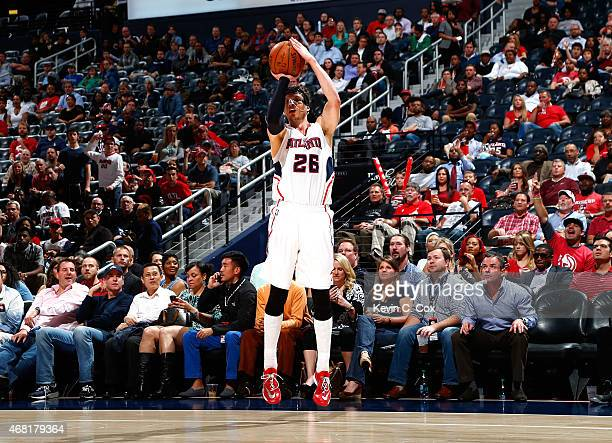 Kyle Korver of the Atlanta Hawks shoots a threepoint basket against the Milwaukee Bucks at Philips Arena on March 30 2015 in Atlanta Georgia NOTE TO...