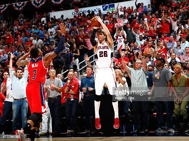 Kyle Korver of the Atlanta Hawks shoots a threepoint basket over Bradley Beal of the Washington Wizards during Game Two of the Eastern Conference...