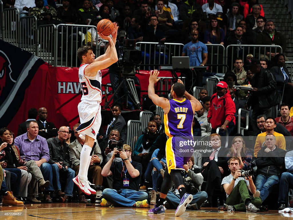 Kyle Korver #26 of the Atlanta Hawks shoots the ball against the Los Angeles Lakers on December 16, 2013 at Philips Arena in Atlanta, Georgia.