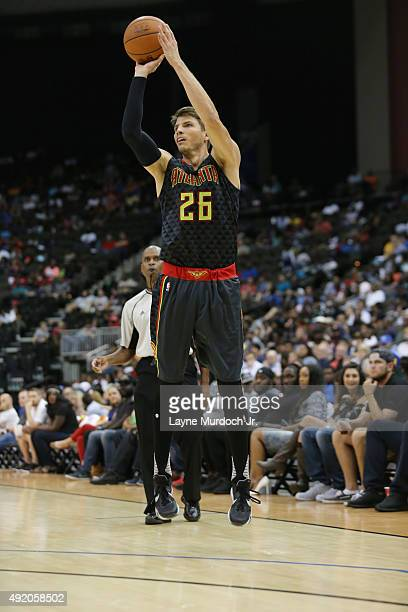 Kyle Korver of the Atlanta Hawks shoots the ball against the New Orleans Pelicans during a preseason game on October 9 2015 at the Jacksonville...