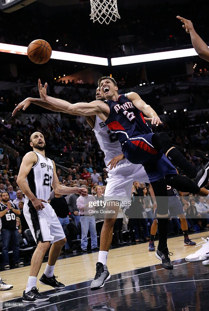 Kyle Korver of the Atlanta Hawks shoots the ball while Tim Duncan of the San Antonio Spurs defends him at the ATT Center on November 5 2014 in San...