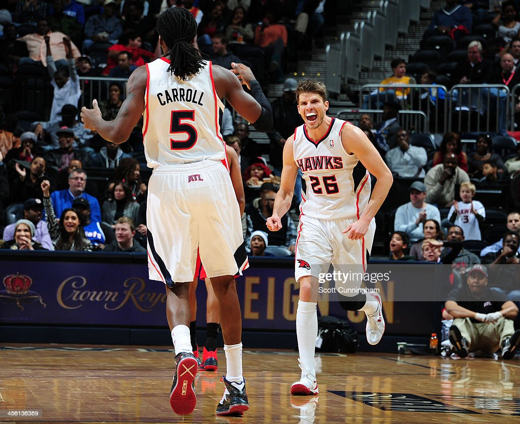 <a gi-track='captionPersonalityLinkClicked' href=/galleries/search?phrase=Kyle+Korver&family=editorial&specificpeople=202504 ng-click='$event.stopPropagation()'>Kyle Korver</a> #26 of the Atlanta Hawks smiles after winning the game against the Washington Wizards on December 13, 2013 at Philips Arena in Atlanta, Georgia.