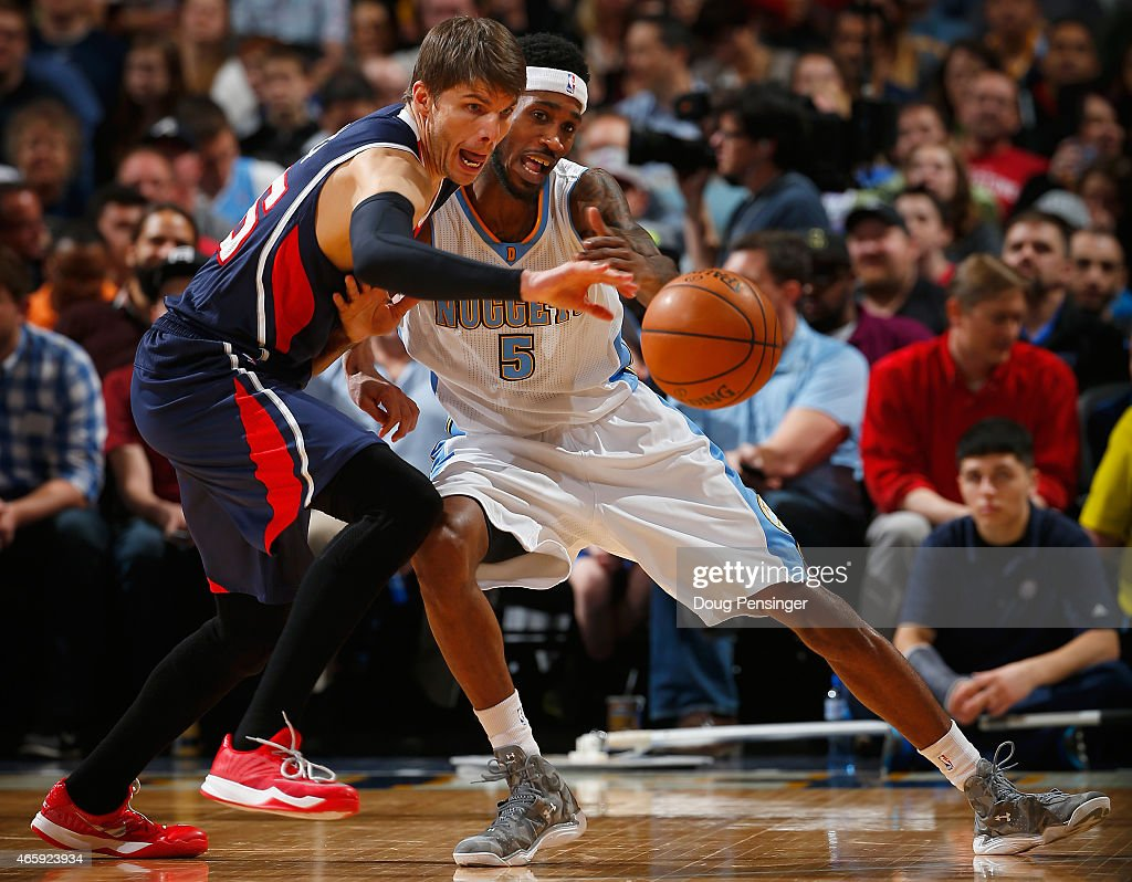 Kyle Korver of the Atlanta Hawks steals the ball from Will Barton of the Denver Nuggets at Pepsi Center on March 11 2015 in Denver Colorado NOTE TO...
