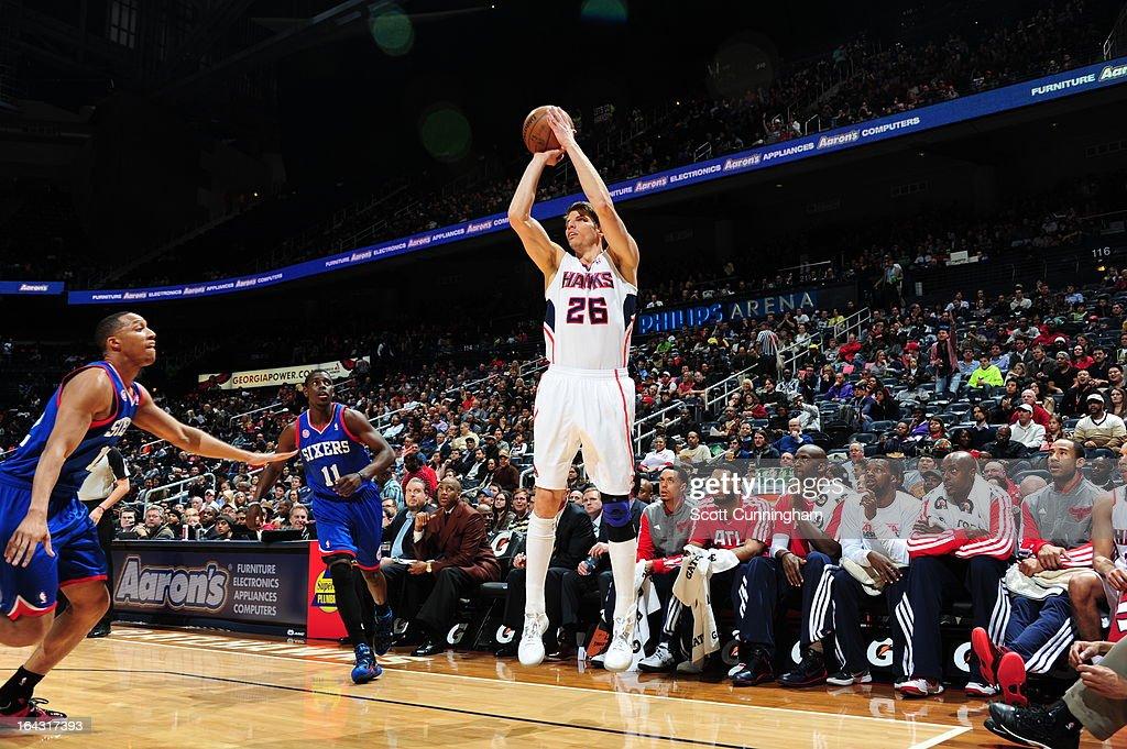 Kyle Korver #26 of the Atlanta Hawks takes a shot against the Philadelphia 76ers on March 6, 2013 at Philips Arena in Atlanta, Georgia.