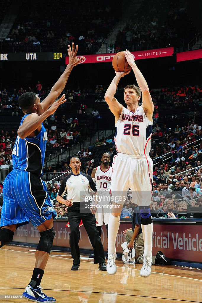 Kyle Korver #26 of the Atlanta Hawks takes a shot against the Orlando Magic on March 30, 2013 at Philips Arena in Atlanta, Georgia.