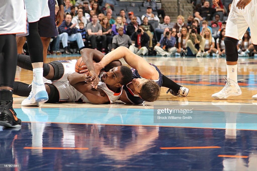 <a gi-track='captionPersonalityLinkClicked' href=/galleries/search?phrase=Kyle+Korver&family=editorial&specificpeople=202504 ng-click='$event.stopPropagation()'>Kyle Korver</a> #26 of the Atlanta Hawks wrestles against <a gi-track='captionPersonalityLinkClicked' href=/galleries/search?phrase=Michael+Kidd-Gilchrist&family=editorial&specificpeople=8526214 ng-click='$event.stopPropagation()'>Michael Kidd-Gilchrist</a> #14 of the Charlotte Bobcats during the game at the Time Warner Cable Arena on November 11, 2013 in Charlotte, North Carolina.