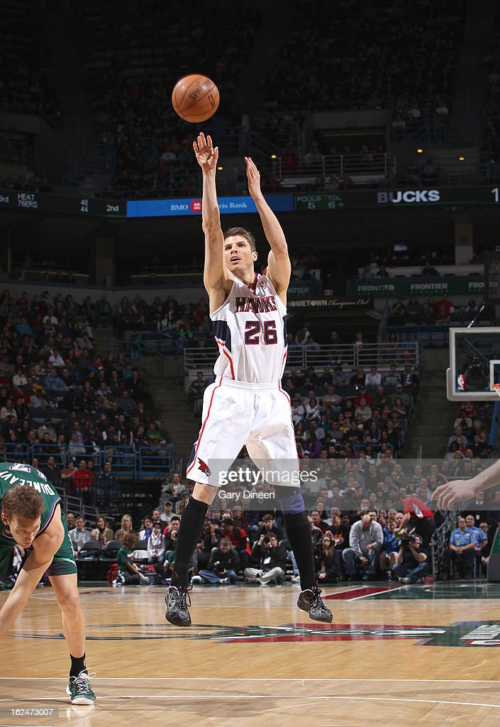 Kyle Korver #26 of the Atlanta Hawsk shoots against Mike Dunleavy #17 of the Milwaukee Bucks on February 23, 2013 at the BMO Harris Bradley Center in Milwaukee, Wisconsin.