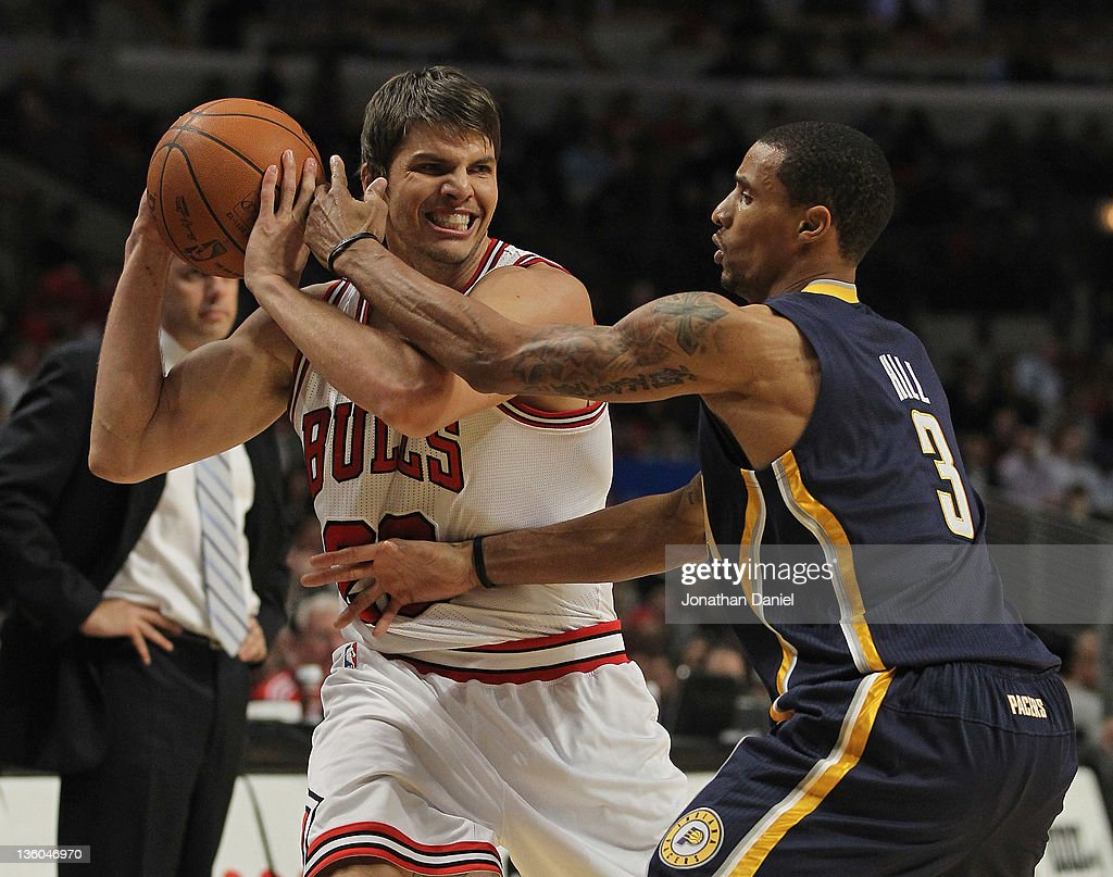 <a gi-track='captionPersonalityLinkClicked' href=/galleries/search?phrase=Kyle+Korver&family=editorial&specificpeople=202504 ng-click='$event.stopPropagation()'>Kyle Korver</a> #26 of the Chicago Bulls fights off George Hill #3 of the Indiana Pacers at the United Center on December 20, 2011 in Chicago, Illinois. The Bulls defeated the Pacers 93-85.