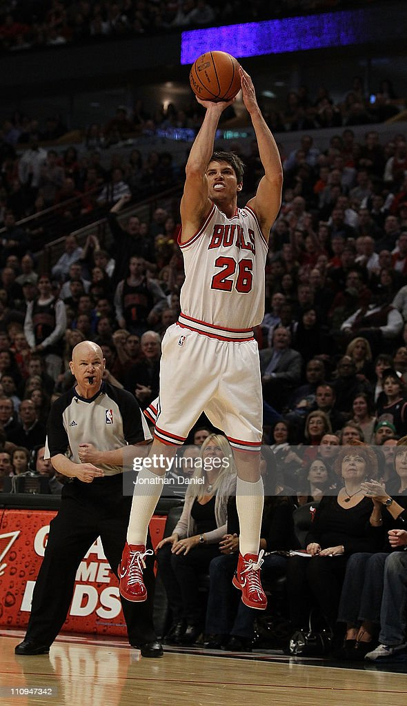 Kyle Korver #26 of the Chicago Bulls puts up a 3 point shot in front of referee Joey Crawford #17 against the Memphis Grizzlies at the United Center on March 25, 2011 in Chicago, Illinois. The Bulls defeated the Grizzlies 99-96.