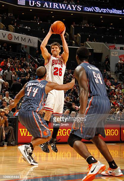 Kyle Korver of the Chicago Bulls shoots over Dante Cunningham of the Charlotte Bobcats on March 9 2011 at Time Warner Cable Arena in Charlotte North...