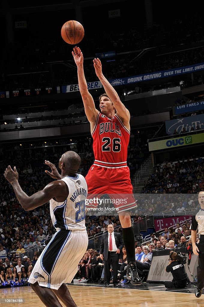 <a gi-track='captionPersonalityLinkClicked' href=/galleries/search?phrase=Kyle+Korver&family=editorial&specificpeople=202504 ng-click='$event.stopPropagation()'>Kyle Korver</a> #26 of the Chicago Bulls shoots over <a gi-track='captionPersonalityLinkClicked' href=/galleries/search?phrase=Jason+Richardson+-+Basketball+Player+-+Born+1981&family=editorial&specificpeople=201558 ng-click='$event.stopPropagation()'>Jason Richardson</a> #23 of the Orlando Magic on March 4, 2011 at the Amway Center in Orlando, Florida.