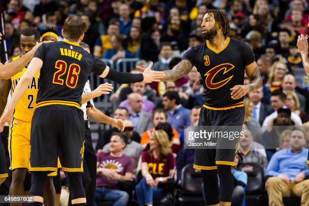 Kyle Korver of the Cleveland Cavaliers and Derrick Williams celebrate after scoring during the first half against the Indiana Pacers at Quicken Loans...