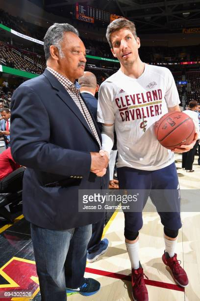 Kyle Korver of the Cleveland Cavaliers and Jesse Jackson shake hands before the game against the Golden State Warriors in Game Three of the 2017 NBA...