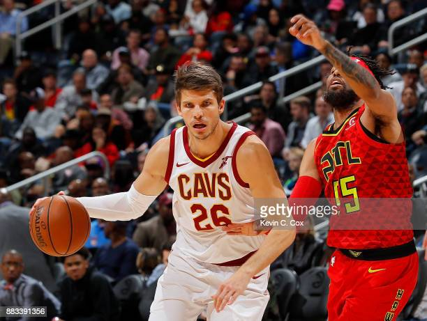 Kyle Korver of the Cleveland Cavaliers drives against DeAndre' Bembry of the Atlanta Hawks at Philips Arena on November 30 2017 in Atlanta Georgia...